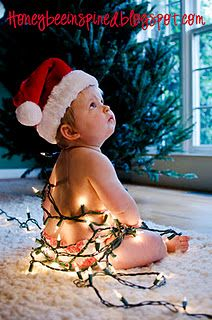 Tutorial: How to take a picture of your baby wrapped in Christmas lights.  : )