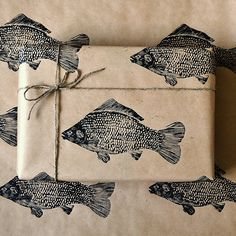 Unusual hand-printed fish wrapping paper.Our gift wrap comes carefully folded in a board backed envelope. If you would prefer it rolled please choose this option from the drop down menu. Available in quantities of onw, two and three sheets.This lino printed fish gift wrap was designed specifically for men in mind. It would make a fun finishing touch for a birthday or Father's Day gift. Our designs are created in house and individually stamped onto eco friendly brown kraft paper. You will ...