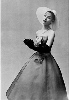 1957 Renée Breton in white organza dress under layer of black voile by Christian Dior