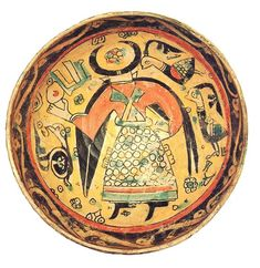 Nishapur bowl featuring human and animal subjects rendered in a distinctive palette of yellow, green, red, green, red and black. This bowl is unusual it its depiction of a man with crescent horns in place of a head.  Cf. Charles Wilkinson, Nishapur: Pottery of the Early Islamic Period, plate 2.  Size:  	Diameter 8 7/8? (22.5cm) 	  Period:  	10th century AD 	  Condition:  	minor restoration.