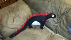 Dinosaur I made for my nephew. I used my huband's old jeans and felt.
