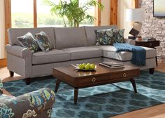 This beautiful chaise sectional sofa presents a wonderful style highlight for your living room. Blending contemporary and vintage styles, the sectional showcases rolled arms and tall, exposed wood legs. With seat and back cushions for additional comfort and support, this elegant piece will let you relax in style.