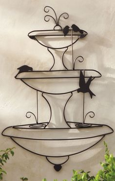 """""""Birds in a Fountain"""" Wall Art provides all the character of the iconic garden embellishment that fits on a wall."""