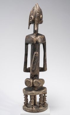 Dogon peoples Figure (Dege), mid 20th century or earlier Mali, Bandiagara Circle Wood and metal 31 5/8 × 7 1/4 × 8 3/8 in. (80.3 × 18.4 × 21.3 cm) 3-D Object-Sculpture X 2034