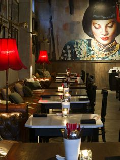 Mama San Restaurant and Bar in Bali, Indonesia...love the red lamp shades & large mural.