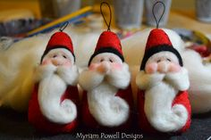 Needle felted Santa ornaments by Myriam Powell www.myriampowelldesigns.etsy.com