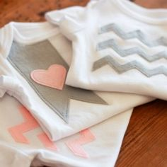 Create this fun little trio of appliqued one pieces with this easy tutorial