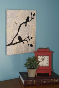 DIY Bird Wall Art - modge podge old book pages onto a canvas, free hand tree branches and birds with perm marker