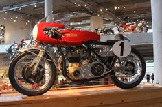 A 1962 Surtees/Matchless on display with other classic motorcycles at the Barber Vintage Motorsports Museum in Leeds, Alabama. Ajs Motorcycles, British Motorcycles, Cafe Racing, Classy Cars, Vintage Racing, Sport Bikes, Cool Bikes, Motorbikes, Bike Stuff