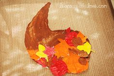 Cornucopia Craft w/ Printables included. Thanksgiving craft for kids.- Did this with watercolors in EHS Thanksgiving Art Projects, Thanksgiving Crafts For Kids, Thanksgiving Activities, Fall Crafts, Holiday Crafts, Daycare Crafts, Classroom Crafts, Preschool Crafts, Toddler Crafts
