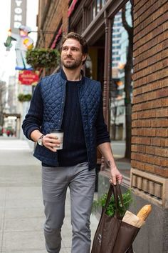 Marry a dark blue quilted gilet with grey jeans to effortlessly deal with whatever this day throws at you.  Shop this look for $83:  http://lookastic.com/men/looks/grey-jeans-navy-cable-sweater-navy-quilted-gilet/5145  — Grey Jeans  — Navy Cable Sweater  — Navy Quilted Gilet