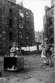 Jenny Lamont and her friends play with tin cans in the yard behind tennemants of Florence Street, in the Gorbals area of Glasgow. At the time of this photograph the Scottish Office had plans to. Get premium, high resolution news photos at Getty Images Gorbals Glasgow, The Gorbals, Glasgow Scotland, Scotland Travel, Uk Housing, Coventry Cathedral, Glasgow City, Glasgow School Of Art, Rio Carnival