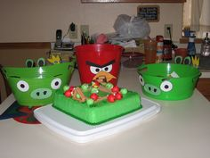 I made angry bird buckets to go with the theme of the birthday!  We ate pigs in a blanket, worms, and cheetoes puffs.