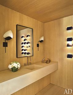 The powder room is lit by a pair of vintage Mouille sconces and a set of Charlotte Perriand CP1 wall lights.  (pinned by Danielle Lake Design, www.daniellelakedesign.com)