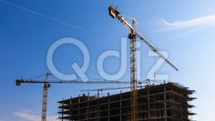 Qdiz Stock Photos | Building cranes on construction,  #architecture #blue #build #building #built #business #City #construct #construction #crane #development #engineering #equipment #estate #growth #house #industrial #industry #modern #site #sky #steel #technology #urban #work
