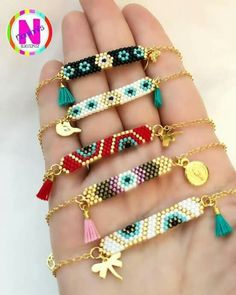 Double Triangle weaving of Perle gilded with fine gold - Salvabrani Love these beaded bracelets with the mix of tassles and charms. Bead Jewellery, Seed Bead Jewelry, Bead Earrings, Jewelery, Jewelry Necklaces, Bead Loom Bracelets, Beaded Bracelet Patterns, Beading Patterns, Beading Ideas