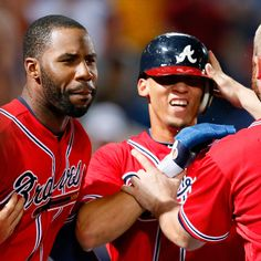 Andrelton Simmons #19 of the Atlanta Braves celebrates scoring the game-winning run on a walk-off single by Tyler Pastornicky #1 of the Atlanta Braves in the ninth inning against the Washington Nationals