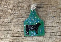 Green and blue sparkly ear tag pendant with black beef silhouette and a rhinestone pinch bail. Repin to be entered to win one of four $50 gift certificates during our Five Year Anniversary Celebration in July 2014.