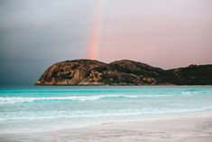 Rainbow at Lucky Bay in Cape Le Grand National Park, Western Australia. / Check out more travel photos and blog posts on frugalfrolicker.com