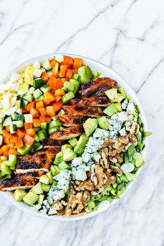 Cobb Salad is one of my favorite salads. It has been since the first time I had it back during my freshman year of college. I recently had a few friends over for a cheese night and had a bit of leftover Blue Cheese. So I decided I was going to make something like that with the leftovers, but I had a craving for Buffalo Wings too. I love the combo of Blue Cheese and Buffalo Chicken I thought a Buffalo Chicken Cobb Salad would be a fun twist on the traditional cobb salad. It has some of the…