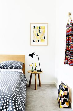 An eclectic bedroom with bold patterns and colors