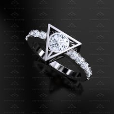 These 'Harry Potter' Engagement And Wedding Rings Are Magical – Fashionably Geek Harry Potter Ring, Harry Potter Engagement Ring, Harry Potter Wedding Rings, Bijoux Harry Potter, Harry Potter Schmuck, Princess Wedding Rings, Harry Potter Accessories, Custom Wedding Rings, Geek Engagement Rings