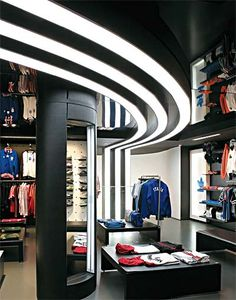 Theme & corporate identity - The design and layout of retail should reflect the product and the overall brand of the company. Adidas retail used their corporate identity to make a lighting and ceiling design to the retail. Design Shop, Design Blogs, Shop Interior Design, Display Design, Retail Design, Store Design, Adidas Store, Wall Paper Decor, Design Commercial