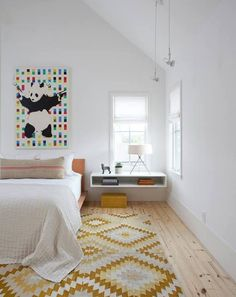 including the panda art :) Wall art and chic rug add color and pattern to the stylish Scandinavian bedroom [Design: Texas Construction Company] Gray Bedroom, Home Bedroom, Master Bedroom, Bedrooms, Scandinavian Bedroom Decor, Scandi Bedroom, Scandinavian Style, Wooden Platform Bed, Decoration Chic