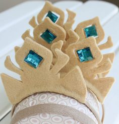 Elsa Inspired Crown by BubblyandButtonyShop on Etsy, $20.00 - What little girl does not want this Elsa inspired crown from her coronation day?  Love it!