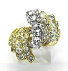 Ladies 14kt yellow gold diamond estate ring. Ring contains 39 brilliant round cut diamonds weighing approximately 2.25ct total weight.