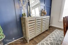 We're always open to your design suggestions! This customer brought in a photo of a sideboard she saw elsewhere and loved. She wanted a similar sideboard in her home and wondered if E. Braun Farm Tables could help. Why yes, we could. :) That small photo provided the inspiration for our interpretation of the piece. Handcrafted using medium character reclaimed white pine barn wood, it completes her chic dining room decor.