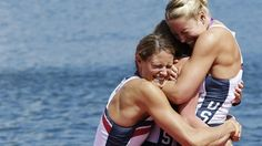 A member of the U.S. women's eight team embraces coxswain Mary Whipple after winning the gold medal.