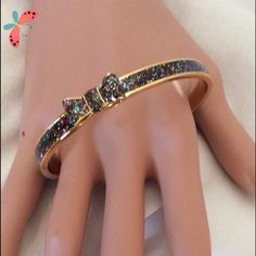 TAKE A BOW BANGLE Slide on bangle , by Kate Spade , inner diameter 2.5 , it's a glitter bow, that looks great with anything....comes with dust bag.... kate spade Jewelry Bracelets