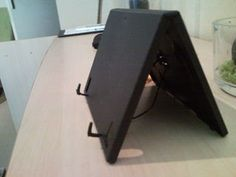 Adjustable tablet stand with DVD case ( Ipad / Touchpad )