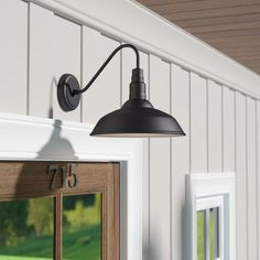 From complementing architectural details to offering a well-lit welcome for guests, the right outdoor light catapults your curb appeal to new heights. This metal barn light brings modern farmhouse character to front doors, screened-in porches, and garages Outdoor Barn Lighting, Outdoor Sconces, Outdoor Wall Lantern, Rustic Lighting, Outdoor Walls, Lighting Design, Lighting Ideas, Gooseneck Lighting Outdoor, Backyard Lighting