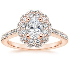 Jessie and Cassie- This one- Marquise Cut Diamond in center - Thanks! 14K Rose Gold Rosa Diamond Ring (3/4 ct. tw.) from Brilliant Earth