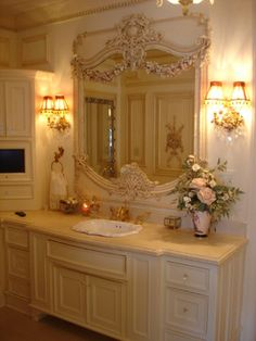 One day I hope to have a master bed and bath inspired by French provincial furnishing with a few modern pieces mixed in and pops of color!