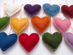 100% hand cut and hand stitched heart ornaments in the colors of the rainbow. Set of 12. They were made of wool felt, stuffed with polyfill. Satin ribbon is stitched securely.  Perfect as gift tags or holiday decoration (Birthday, Anniversary, Christmas, Wedding, Valentine's Day).  Felt colors: white, dark purple, medium blue, wine red, spinach green, yellow, orange, pink, dark blue, red, dark green, lilac.  12 Rainbow Felt Heart Ornaments Handstitched Home by adrisboltja,   【 $34.00 】