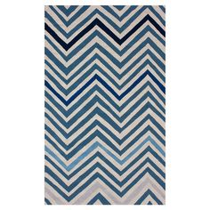 Hand-hooked wool rug with a chevron motif.  Product: RugConstruction Material: WoolColor: Blue