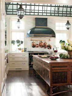 ThisArts and Crafts style-inspired kitchen is ultra-luxe. The stunning island takes center stage, featuring burled wood and a small prep sink