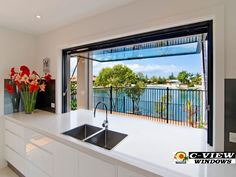 Gas Strut Window at Palm Beach QLD by C-View Windows. Great servery window option