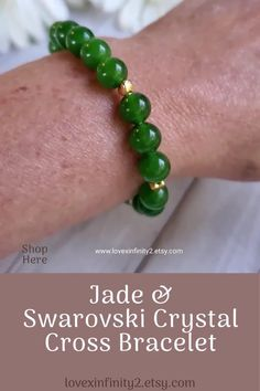 This Green Jade Gemstone Cross bracelet is made with 8mm Chinese green jade beads, tiny gold heart spacers, and features a brilliant Swarovski Crystal Cross accent bead..Feng Shui Jade is known for harmony, balance, protection and for good luck. It is said to bless whatever it touches bringing love, wealth, prosperity, and abundance.#crossbracelet #christianbracelet #religiousjewelry #christianjewelry #christiangifts #religiousgifts #swarovski #jade #cross