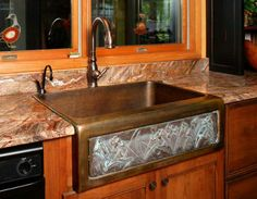 A copper farmhouse sink!