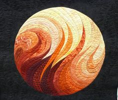 """Art quilt fire sun orange red gold yellow""  Motion, heat, passion.. never realized a quilt could be so sexy."