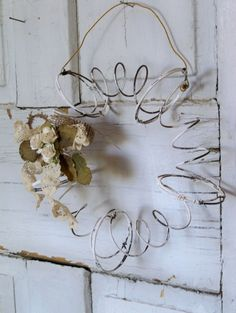 Rusty metal recycled wreath salvaged bed springs primitive farmhouse wall decor Anita Spero. $35.00, via Etsy.