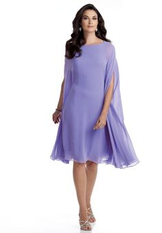 Dress features beading and cape sleeves.