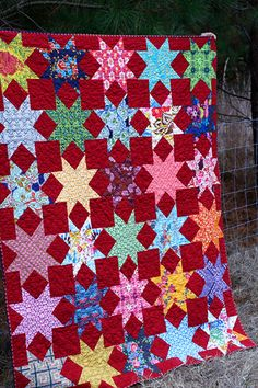 red, red Stars quilt with continuous 8 quilting by StitchedInColor, via Flickr