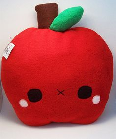 """Shy Apples are grown in the deepest and highest reaches of apple trees. Although rare and difficult to harvest, Shy Apples are the sweetest of fruits and possess many nutrients."" Includes an attached name tag with the above description on the reverse. Size: 11 x 9 inches These plush pi..."