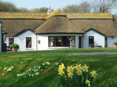 Your spacious, comfortable, thatched cottage awaits. 'twixt flower gardens and seaside it's in a truly idyllic setting!