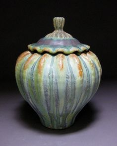 Lidded Jar, ribbed body, waved lid with ribbed knob, light green patina with terra cotta accents